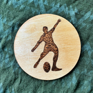 Rugby Kicker 10cm diameter wooden drink coaster or fridge magnet, wood-burned.