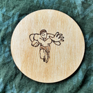Rugby Player 10cm diameter wooden drink coaster or fridge magnet, wood-burned.