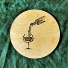 Red Wine Flowing 10cm diameter wooden drink coaster or fridge magnet.