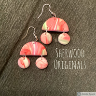 Pretty pastel pink dangle drop earrings.