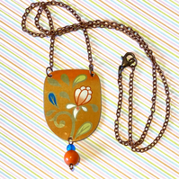 Vintage tin U shaped orange floral beaded pendant necklace