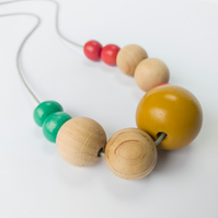 Ellie - Red, green mustard and natural coloured beaded adjustable necklace