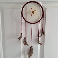 Dreamcatcher in plum colour with contrasting feathers and beads 6 x 16 inches