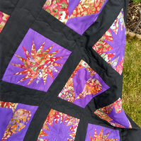 Black and Purple patchwork quilt