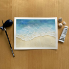 An original watercolour painting of blue waves breaking on a sandy beach