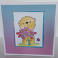 Bear with flowers card