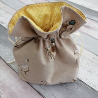 Toiletry bag for cosmetics and personal items. Drawstring bag with Ducks pattern