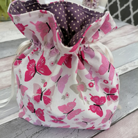 Cosmetic bag with a pink butterfly pattern. Personal items storage bag.