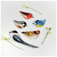 A gift set of fused glass birds to hang in your home
