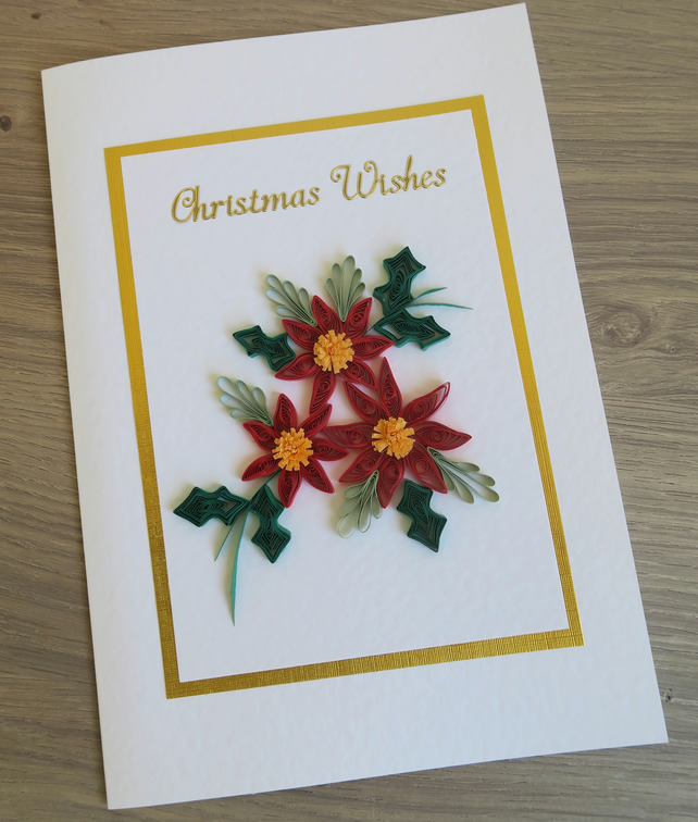 Handmade, quilled Christmas card, with poinsettias and holly
