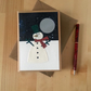 Snowman Christmas Notebook with grey pages. Alternative Christmas Card.