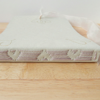 Cream leather Wedding Guest Book with heart design stitching