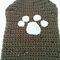 Green and cream trim dog sweater with paw print applique for small sized dog