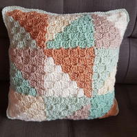 Pale pastel triangle pattern accent cushion