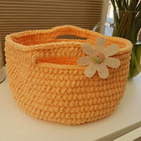 Peachy coral crocheted basket with a jute flower