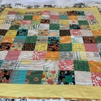 Patchwork quilt using retro mid century fabric