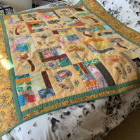 Patchwork quilt with hand appliqued flowers
