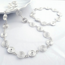 Silver spiral necklace and bracelet set