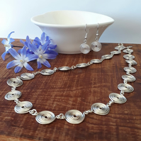 Silver spiral jewellery set, necklace and earrings