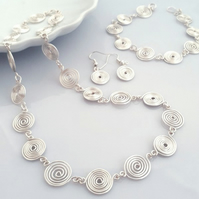 Silver Spiral Jewellery Set, including a necklace, bracelet and earrings,