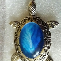 Handmade fluid art turtle pendant blue