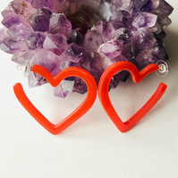 Red heart hoop statement earrings.