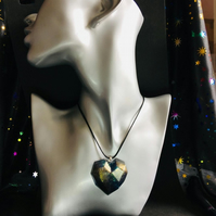 Dark rainbow gold shimmer heart pendant resin and ink with black cord necklace.
