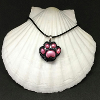 Black paw print pendant with pink toe beans pendant and chain.