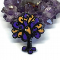 Tree statement brooch Halloween themed black, purple and orange.