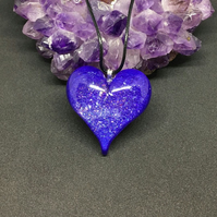 Purple sparkly puffy heart statement pendant with black cord necklace.