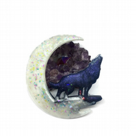 Moon and wolf hanging decoration.
