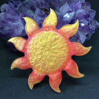 Sun large statement brooch with a roll over clasp.