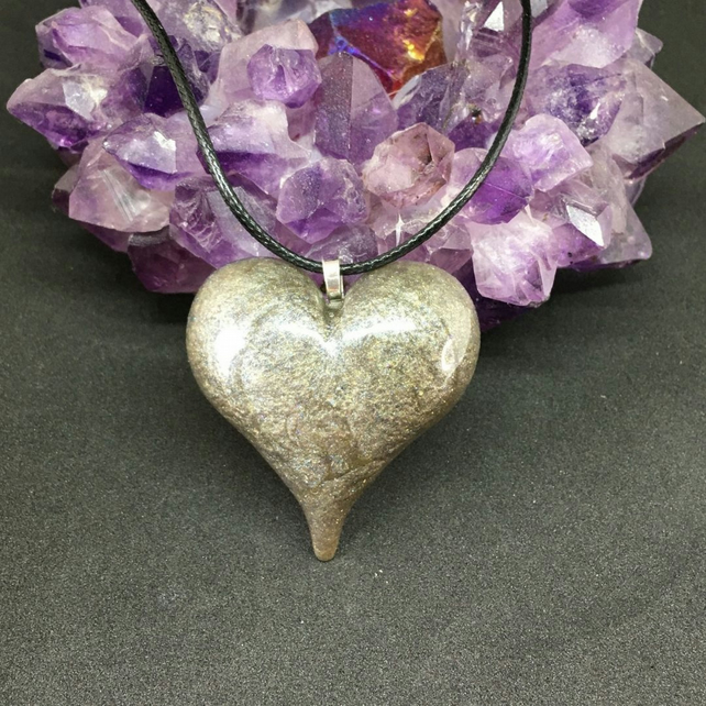 Pewter puffy heart statement pendant with black cord necklace.