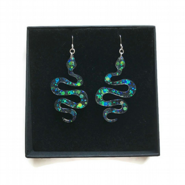 Snake glitter dangle earrings on sterling silver ear wires.
