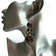 Black glitter dangle circle earrings with sterling silver ear wires.