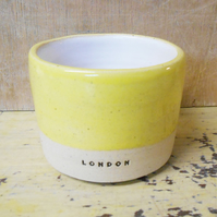 Tumbler London logo in Speckled Yellow.