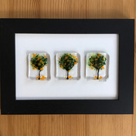 Picture. Orange trees fused glass picture in 6x4 black frame.