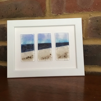 Seascape with rocks triptych fused glass picture in 5x7ins white frame.