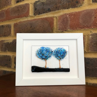 Blue blossom trees original fused glass picture in 5x7ins black or white frame.