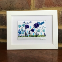 Picture of blue flowers in fused glass, 5x7 white frame. Birthday, anniversary.