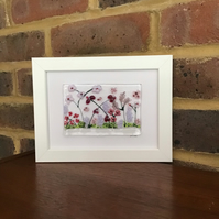 Pink and lilac flowers fused glass picture in 5x7ins white frame.