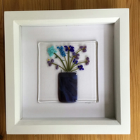 Blue and lilac flowers in marbled vase fused glass picture in 6x6 box frame.