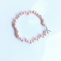 Pretty, pale pink, top drilled, pearl bracelet. Quirky bracelet.
