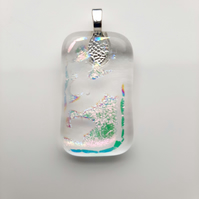 Delicately subtle, clear, fused glass pendant. Makes for a succulent necklace.