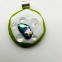 Very quirky, lime green and white, fused glass pendant. Makes for a succulent ne