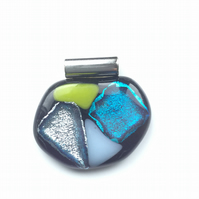 Bold, bright, fused glass pendant. Makes for a succulent necklace.