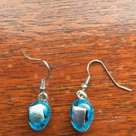 Vibrant, turquoise blue, fused glass, silver dichroic, teardrops. Different and