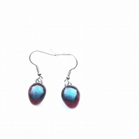 Vibrant, red and purple, dichroic glass, aesthetic earrings. The uncommon colour