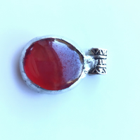 Bright, vibrant red, glass pendant. Quirky setting. Makes a succulent necklace.