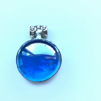 Vibrant, bright blue, round glass pendant. Quirky pendant to make a succulent ne
